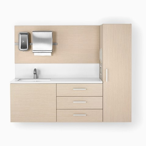 Mora System casework in an ash finish and a white solid surface top and sink. The casework is wall-hung and has 3 drawers and one storage tower.