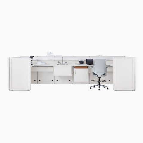 A Co/Struc System laboratory bench in soft white with under-surface storage, a sink, and a Verus Stool in light gray.