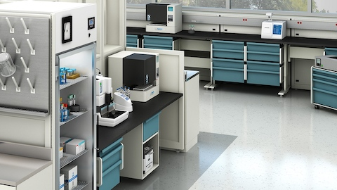 Co/Struc System components in a healthcare laboratory, including drawer units and mobile storage.