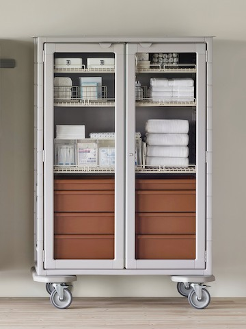 A medical clean supply room featuring a double-wide Procedure and Supply Cart with lockable glass doors.