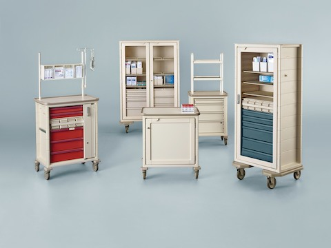 A selection of five mobile storage carts for organizing and transporting healthcare supplies.