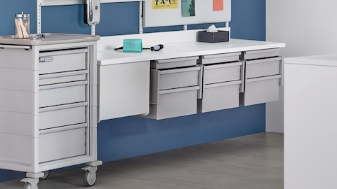 Interchangeable healthcare storage drawers from the modular Co/Struc System, including a cart and rail-hung components.