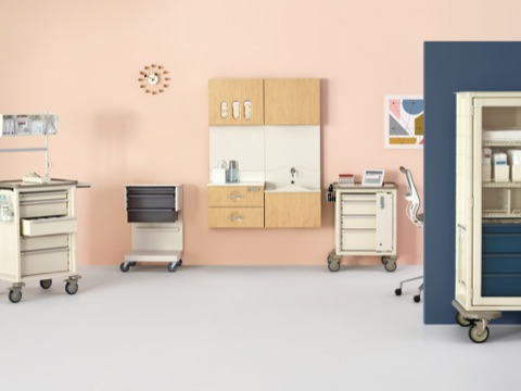 Mobile procedure and supply carts and wall-hung Compass System modules provide flexible storage in a healthcare setting.
