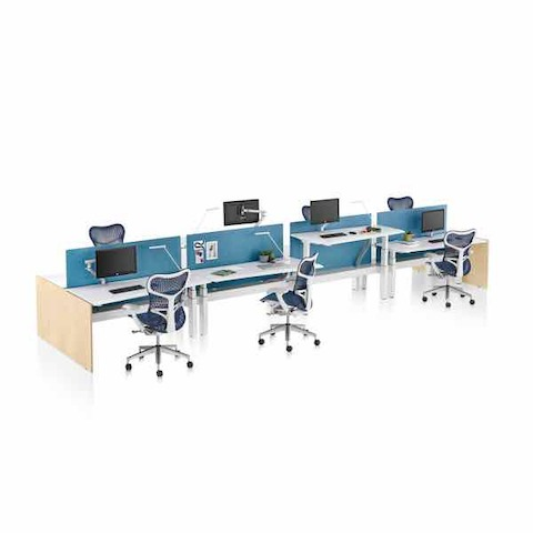 A Renew Link work bench with four workstations on each side and Mirra 2 office chairs.