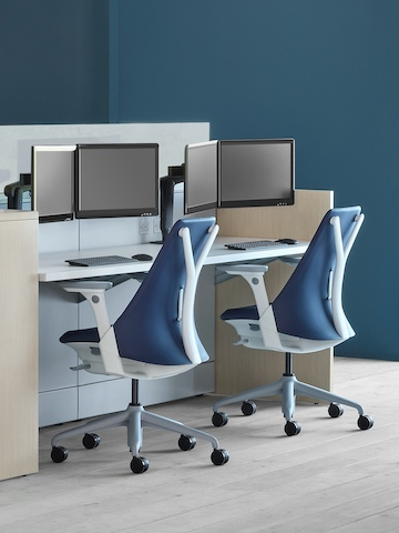 A care team environment with an Ethospace Nurses Station, two Sayl office chairs, and Ollin monitor arms with dual monitors.