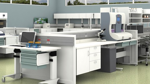 A healthcare laboratory featuring a variety of overhead, base, and mobile storage.