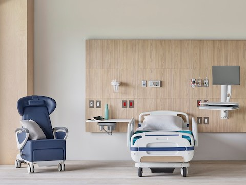 A Compass System headwall in a patient room with a blue Ava Recliner and MBrace technology support.