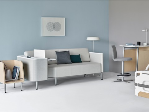 A patient room with a Palisade Flop Sofa, a Palisade Tote, a Palisade Daystand, and an Ode floor lamp.