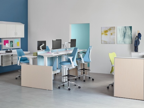 Co/Struc modular storage components, light blue Sayl Stools, and a green Mirra 2 office chair in a healthcare setting.