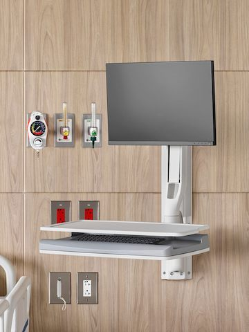 An Mbrace Wall-Mounted Technology with Compass System casework on a patient room headwall.