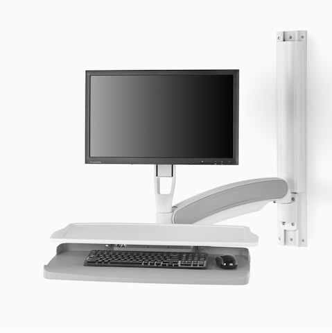 Wall-mounted technology support in a white finish that extends from the wall and holds a monitor arm and keyboard.