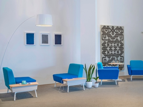 An interaction area featuring various Sabha Collaborative Seating elements in shades of blue.