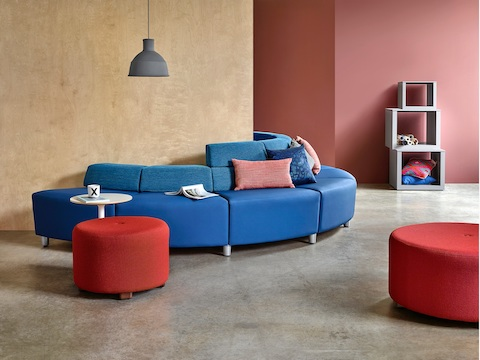 A half-circle configuration of the Steps Lounge System, featuring blue modules with varying back heights.
