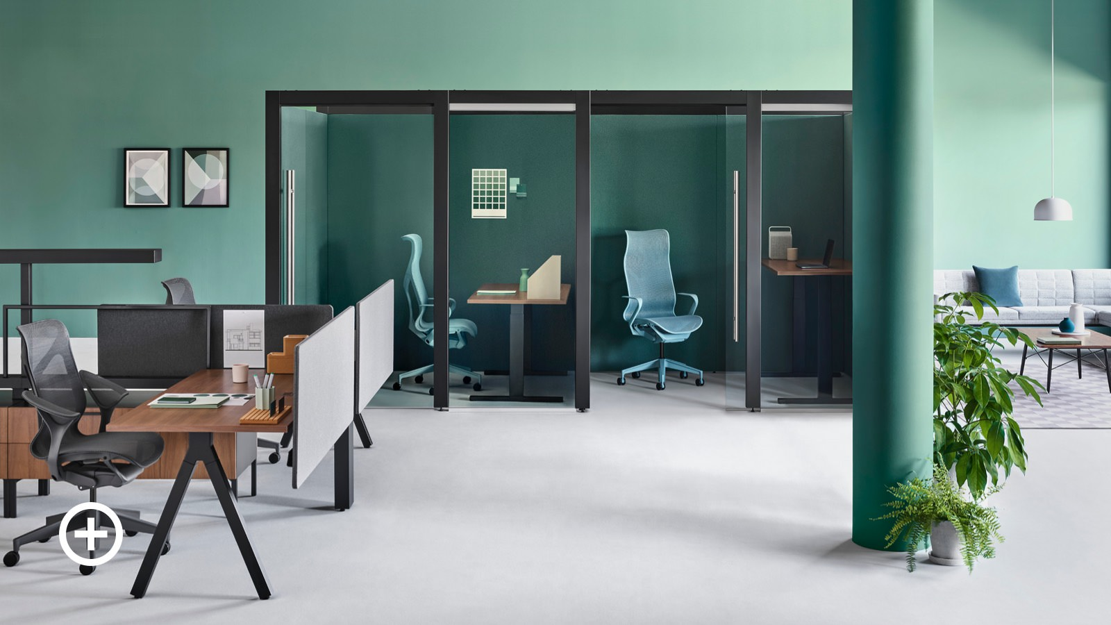 An office setting with two Overlay rooms containing Cosm office chairs and height-adjustable desks and Canvas Vista workstations nearby.