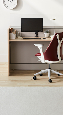 Two supply carts with a single-wide shorter cart in the front and a double-wide tall cart in the back. Both with gray bodies and midnight blue drawers.