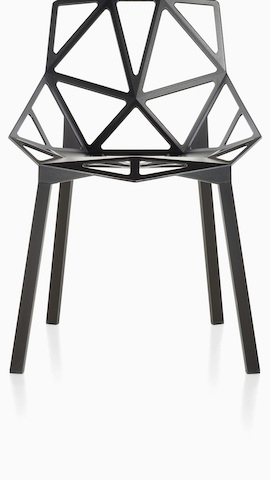 Partial view of a Black Magis Chair_One side chair with a stackable four-leg base, viewed from the front. Select to see outdoor chairs available from the Herman Miller store.
