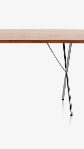 Partial view of a Nelson X-Leg Table. Select to see dining tables available from the Herman Miller Store.
