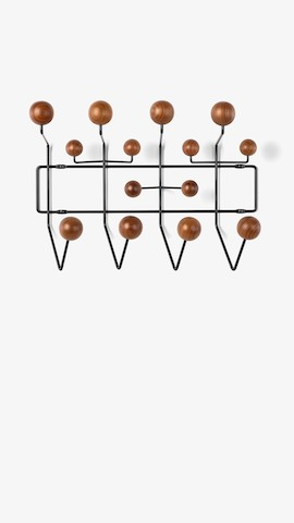An Eames Hang-It-All for hanging storage. Select to see accent items available from the Herman Miller Store.