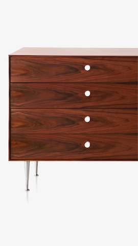 A four-drawer chest from the Nelson Thin Edge Group. Select to see storage items available from the Herman Miller Store.