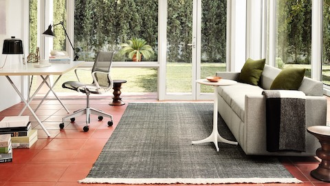 A home office with a Setu Chair and Nelson X-Leg Table. Select to see office chairs available from the Herman Miller Store.