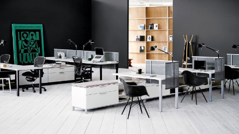 A Hive Setting outfitted with Canvas Office Landscape in white, with black Eames Shell Chairs and black Aeron Chairs.