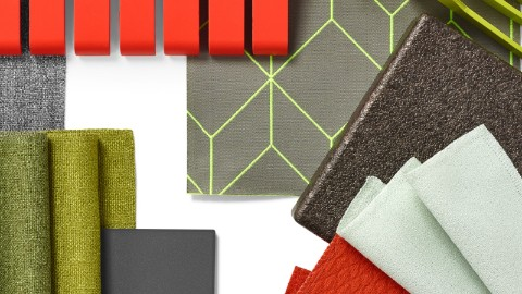 A collage of material swatches in grey, green, and a pop of red.