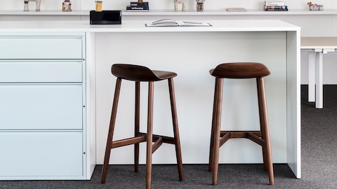 Two Crosshatch Stools provide seating for a standing-height Meridian storage island.