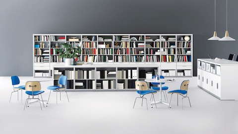 Meridian storage units divide space, provide work surface, and accommodate a corporate library.