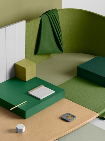 A materials palette featuring greens and neutrals. Select to read how material selection can support organizational purpose.