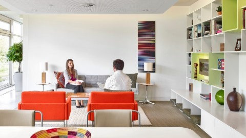 herman miller office design. In This Quiet, Enclosed Haven Setting, A Woman Sits On Grey Tuxedo Sofa Herman Miller Office Design