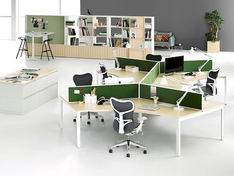 A Living Office Hive Setting outfitted with Canvas Office Landscape, Mirra 2 office chairs, and a Locale bookcase.