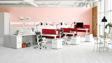 A Hive Setting with a grouping of Renew Sit-to-Stand workstations and Mirra 2 Chairs. People can easily move between individual and group work.