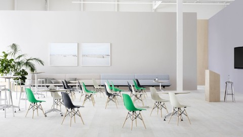 A Forum setting supports the presentation and discussion of content. This one is furnished with green, white, and black Eames Shell Chairs.