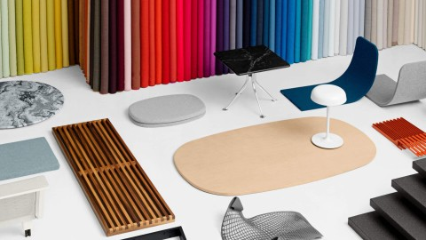 A colorful selection of fabrics and finishes for a workplace design.
