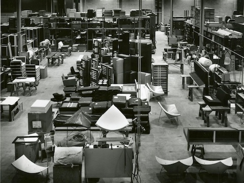 Herman Miller's upholstery department from 1956, showing multiple Coconut Lounge Chairs and other furniture in varying stages of production.