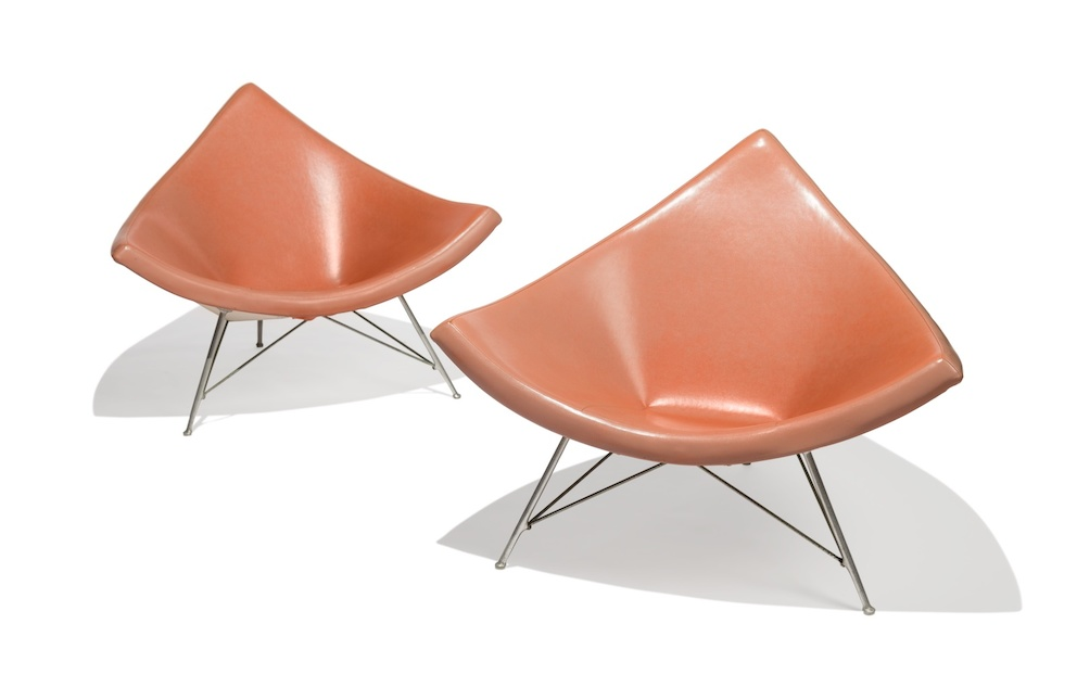 A pair of orange-pink Coconut Lounge Chairs designed by George Nelson's office and manufactured by Herman Miller.