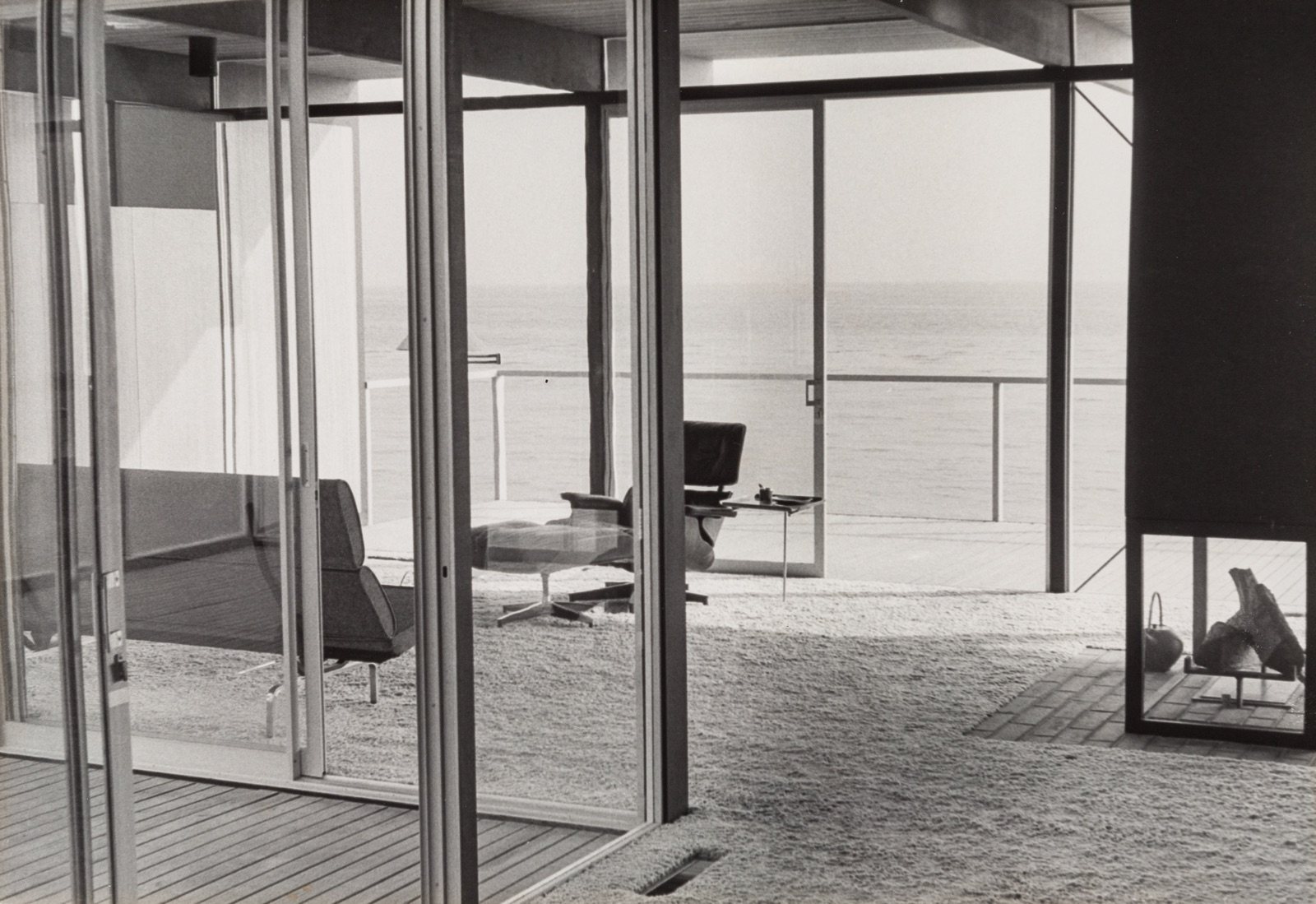 Interior view of Craig Ellwood's Hunt House looking out on the beach in Malibu, California.