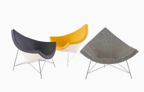 Three of the various material combinations now available on the Nelson Coconut Lounge Chair: black leather, vibrant upholstery, and classic Alexander Girard-designed textiles such as Girard Minicheck.