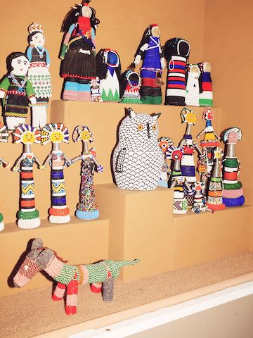 Rare and valuable Native American artifacts collected by Girard—such as these Hopi beadwork pieces—are displayed.