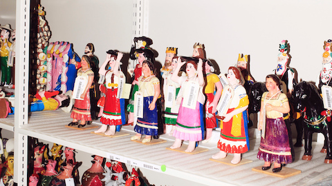Colorful figurines from Alexander Girard's folk art collection. Select to go to an article about the Girard Wing at the Museum of International Folk Art.