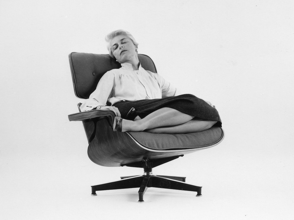 Actress Amanda Dunne in a fabric-covered Eames Lounge