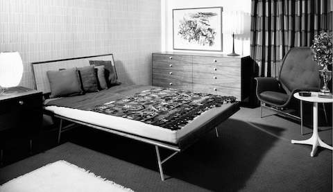 A black-and-white image of a mid-century modern bedroom.