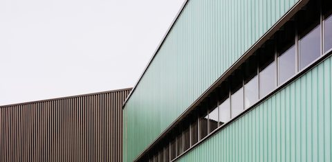 Partial exterior view of Herman Miller's PortalMill facility in the UK.