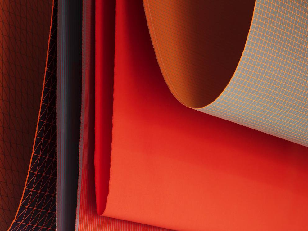 Clove view of textiles in various shades of red and orange.