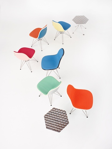 Eames Molded Plastic Side Chairs upholstered in Maharam Checkers.