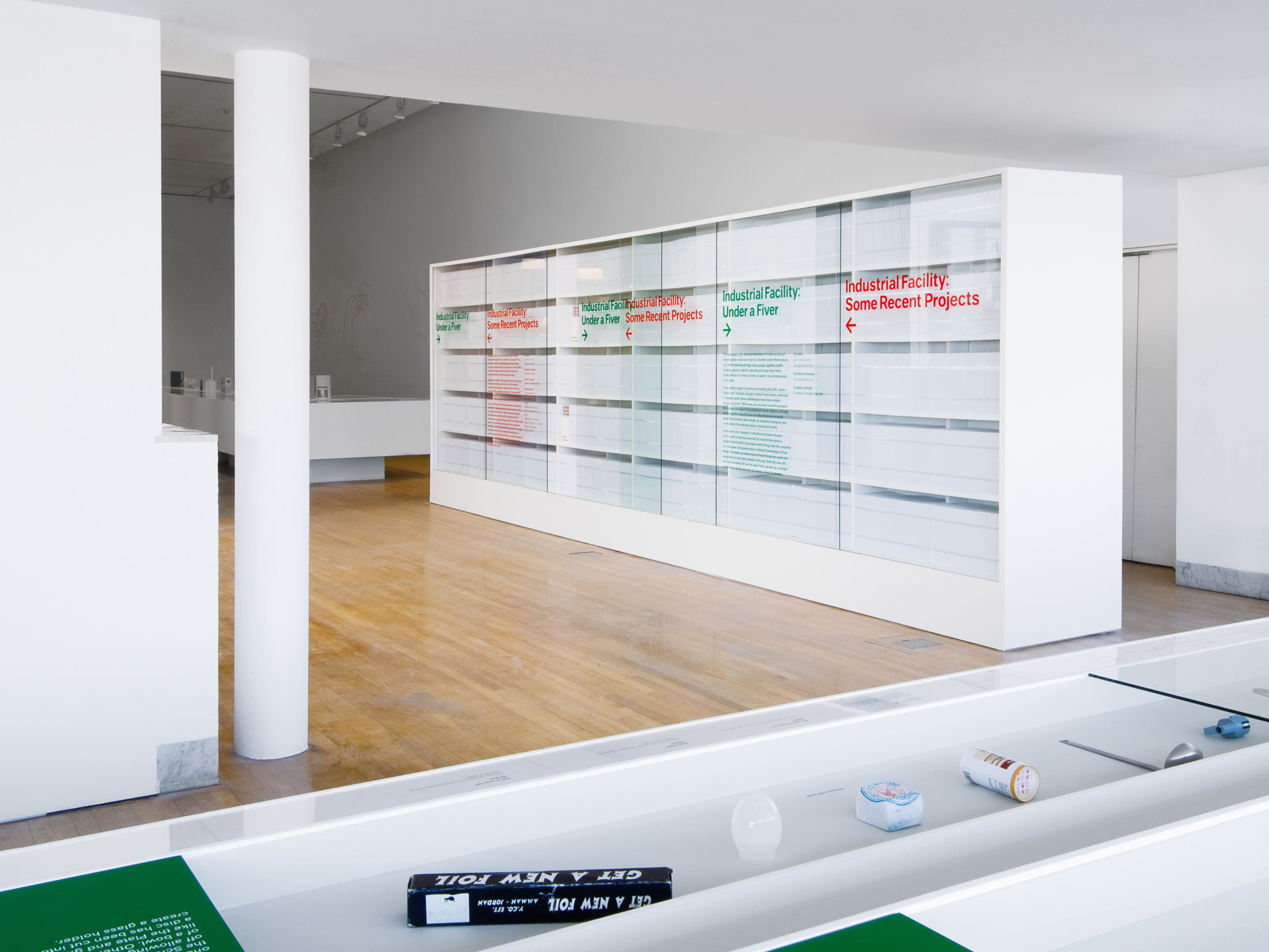 A white bookcase wall used as a wayfinding element at the Design Museum in London.