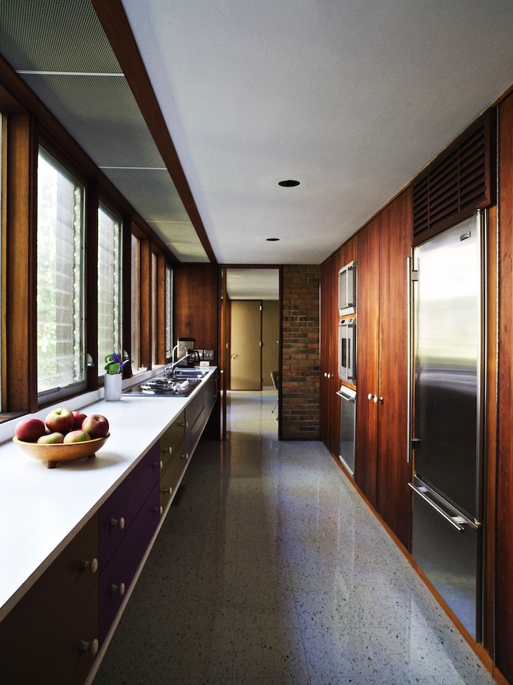 The galley-style kitchen cabinets are all original and were repainted to match Nelson's specifications using the Container Corporation's Color Harmony Manual.