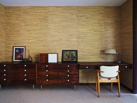 Vintage rosewood Thin Edge cabinets and a custom floating desk line one wall of the master bedroom. The Nelson Miniature Chest was the first vintage Herman Miller piece Corner collected.