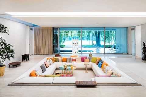 The Miller House was built in 1957 and is credited to architect Eero Saarinen as well as to designer Alexander Girard. One of its most famous features is the colorful conversation pit.