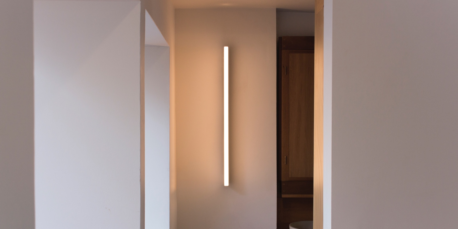 A front view of a Tube Wall Light in the London home of designer Michael Anastassiades.
